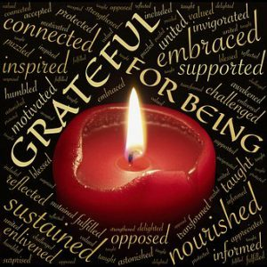 "Word-art that says ""Grateful for being"" and many other words with a candle image."