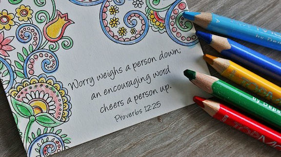 "Word-art that says ""Worry weighs a person down; an encouraging word cheers a person up."" -Proverbs 12:25"