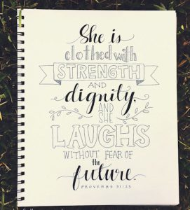 "Word-art that says ""She is clothed with strength and dignity, and she laughs without fear of the future."" - Proverbs 31.25"
