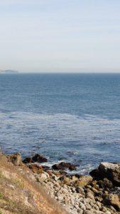 Rocky hill by a seashore.