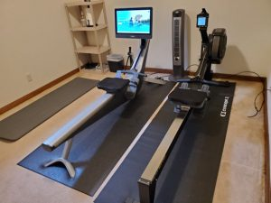 Photo of a new Concept2 rowing machine next to a Hydrow.