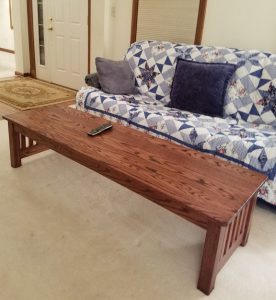 Wood coffee table in front of couch.